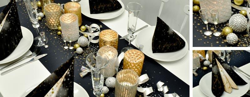 Festliche Tischdekoration in Schwarz kombiniert mit Gold und Silber